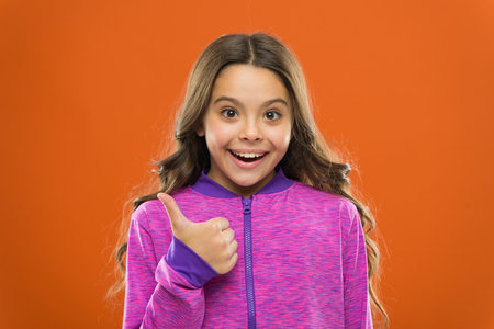 Girl cute child show thumbs up gesture. Gifts your teens will totally love. Kids actually like concept. Kid show thumb up. Girl happy totally in love fond of or highly recommend. Thumb up approvement.
