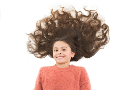 Natural homemade masks that give you healthy beautiful hair. Girl cute child with long curly hair isolated on white. Hair mask recipes. Hairdresser salon concept. Mask for long hair.