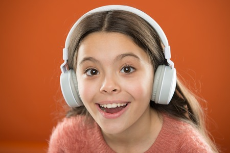 Girl child listen music modern headphones close up. Get music subscription. Access to millions of songs. Enjoy music concept. Best music apps that deserve a listen. Listen for free.