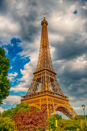 Eiffel Tower at sunset in Paris, France. HDR. Romantic travel background. Eiffel tower is traditional symbol of paris and love. Stock Photo