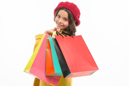 Heavy bags. Small girl with shopping bags. Little shopper. Stock Photo
