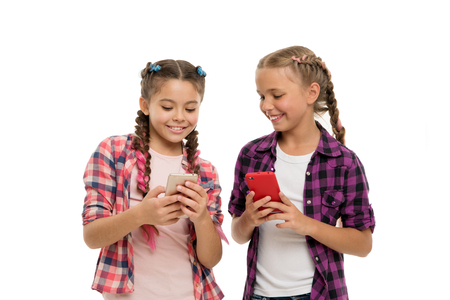 Girls cute small children smiling to phone screen.