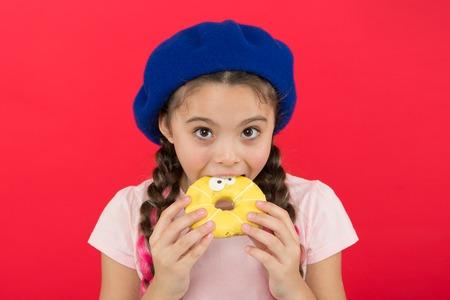 Girl hold glazed cute donute in hand red Reklamní fotografie