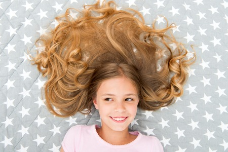 Child curly hairstyle relaxing.