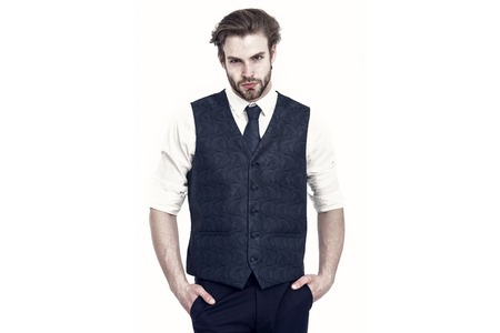 Confident gentleman in waistcoat and tie isolated on white 스톡 콘텐츠