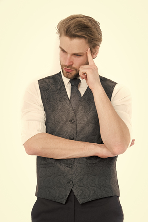 Thinking gentleman in waistcoat and tie isolated on white