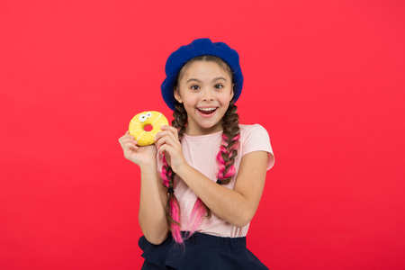 Girl hold glazed cute donut in hand red