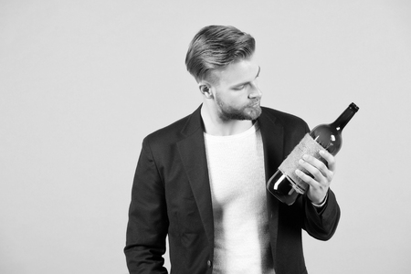 Nice choice. Man holds bottle alcohol drink. Social and cultural aspects of drinking. Reklamní fotografie