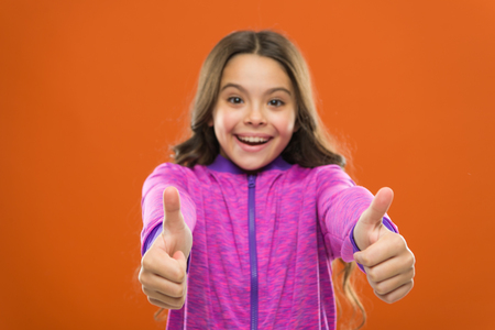 Kid show thumb up. Girl happy totally in love fond of or highly recommend.