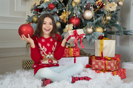 small happy girl at christmas. Happy new year. The morning before Xmas. New year holiday. Christmas. Kid enjoy the holiday. little child girl likes xmas present. Thank you. Everyone will get present. Stock Photo - 113996833