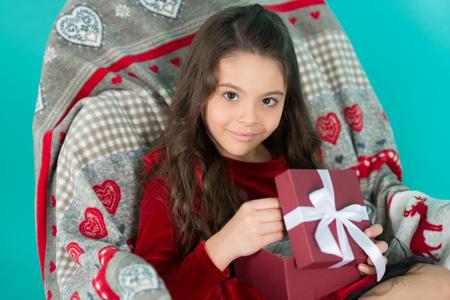 Small girl enjoying christmas gift