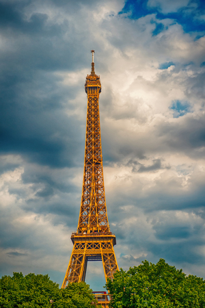 Eiffel Tower at sunset in Paris, France. Romantic travel background. Eiffel tower is traditional symbol of paris and love. HDR