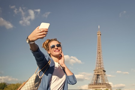Eiffel Tower Paris, France. happy girl making selfie front of Eiffel Tower in Paris. Stock Photo