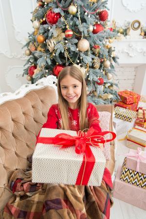 This is for you. Happy child celebrate christmas and new year. Child girl prepare for boxing day holiday. Little girl with gift box. Boxing day is the day after Christmas. Happy new year. Stock Photo