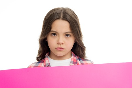 Girl blank surface copy space. Advertisement concept. Child cute girl looking sad while hold paper. Regret to inform you. Sad kid with blank paper advertisement. Bad news. Serious baby hold poster.