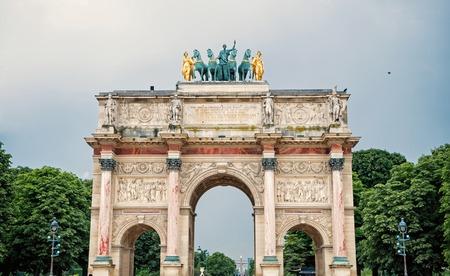 Triumphal Arch Arc de Triomphe du Carrousel at Tuileries gardens in Paris, France. Monument was built between 1806-1808 to commemorate Napoleon's military victories.