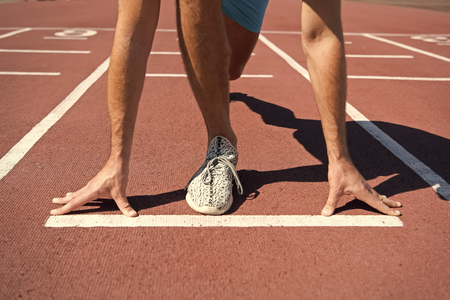 leg of man man start competition running at arena track sunny summer outdoor, workout and health, sport