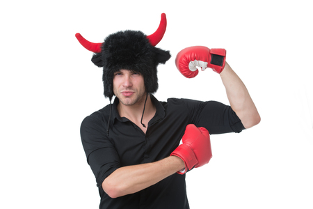 Animal power. Masculinity concept. Man with horns as devil or bull wear boxing gloves. Strong as bull. Strength and power. Man muscular athlete demonstrate power biceps muscle. Energy of bull animal.