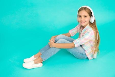 Enjoy music concept. Music always with me. Leisure concept. Little girl listen song headphones. Enjoy track of favorite band. Girl child listen music modern headphones. Get music account subscription.