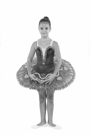 Little ballerina girl in blue tutu. Adorable child in classical ballet position. Little child dance, physical development. Small dancer take dance lesson. Development and learning. Enjoy dancing.