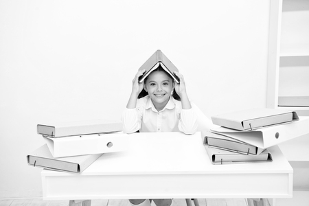 How to stay positive and manage tasks. Girl child book roof head white background. Schoolgirl stay positive smiling reading studying. Kid school uniform smiling face. Schoolgirl hiding from reality.