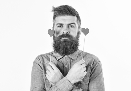 Brutal man with long beard and red hearts. Bearded man, stylish beard concept.