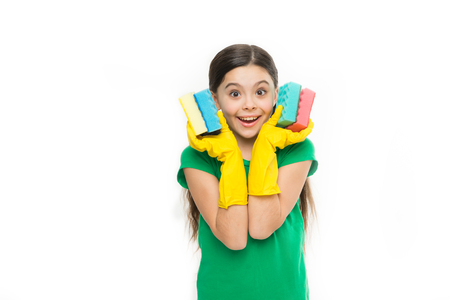 Small housekeeper holding dish sponges in rubber gloves.