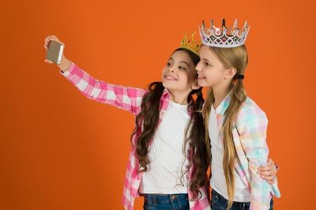 Kids wear golden crowns symbol princess. Warning signs of spoiled child. Avoid raising spoiled kids.
