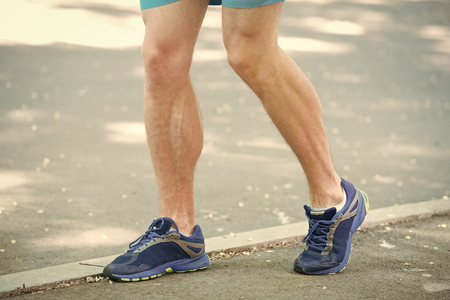 Legs of male athlete runner jogging park sidewalk. Active lifestyle training cardio sport shoes. Vascular disease varicose veins problems active life. Prevent varicose concept. Disease caused by run.