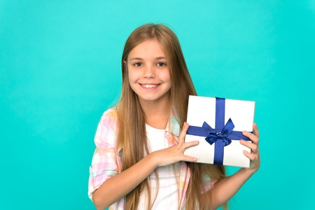 Pleasant surprise. Happy birthday concept. Girl kid hold birthday gift box. Every kid dream about such surprise. Birthday girl carry present. Making gifts. Birthday wish list. Happiness and joy. Stockfoto - 117750761