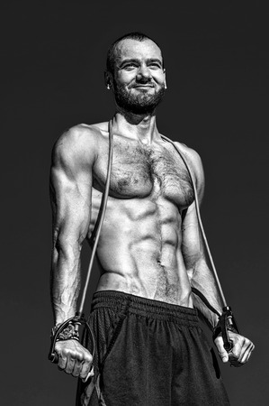 Athletic man with sport equipment. Sport and health care. Achieve great shape with sport lifestyle. My goal is health. Muscular man athlete with strong body workout with sport equipment outdoors.