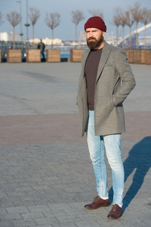 Masculine casual outfit. Hipster outfit. Stylish casual outfit for fall and winter season. Menswear and male fashion concept. Man bearded hipster stylish fashionable coat. Comfortable and cool. Foto de archivo