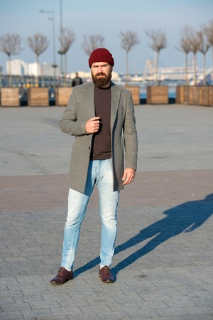 Hipster outfit. Stylish casual outfit for fall and winter season. Menswear and male fashion concept. Man bearded hipster stylish fashionable coat. Comfortable and cool. Masculine casual outfit.