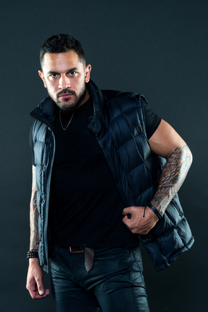 Masculinity and brutality. Tattoo brutal attribute. Tattoo culture concept. Man brutal unshaven hispanic appearance tattooed arms. Bearded man posing with tattoos. Brutal strict macho with tattoos.