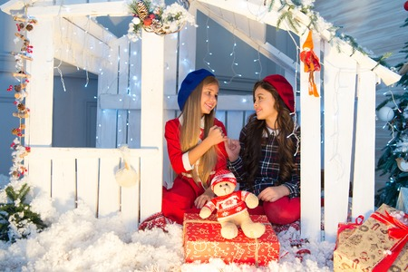 New year surprise. Happy children sit in house with xmas decoration. Little children with toy and Christmas gifts. Celebrating Boxing day. Boxing day is the day after Christmas. The holiday season. Фото со стока