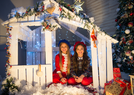 Cute little children girl with xmas present. happy little girls sisters celebrate winter holiday. christmas time. happy new year. delivery christmas gifts. Family holiday. I wish. self made house. Stok Fotoğraf