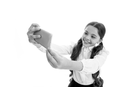 selfie mania. perfect selfie. little girl makes selfie on smartphone. selfie mania and weblog of little girl. stay online