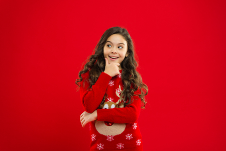New year party. Santa claus kid. Little girl child in santa red hat. Christmas shopping. Present for Xmas. Childhood. Happy winter holidays. Small girl. what will we do. Stock Photo