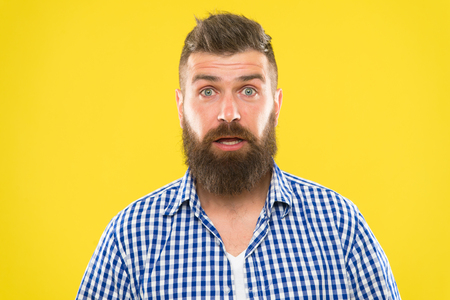 Hipster with beard and mustache emotional surprised expression. Rustic surprised macho. Surprising news. Man bearded hipster wondering face yellow background close up. Guy surprised face expression.