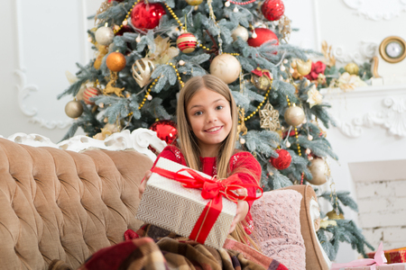 This gift is meant for you. Little girl with gift box. Child girl prepare for boxing day holiday. Happy child celebrate christmas and new year. Boxing day is the day after Christmas. Happy new year.