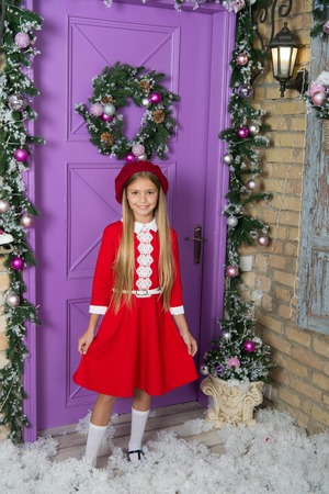 Surprisingly chic party ensemble. Fashionable small child. Small model with fashion look. Little fashionista on xmas decoration. Fashion girl go to Christmas party. Little girl child in xmas dress.