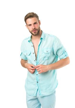 It is hot here. Man handsome bearded guy undressing white background isolated. Guy confident attractive macho feels while unbuttoning shirt. I will show you my body. Want to see torso.