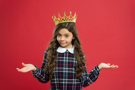 World spinning around me. Kid wear golden crown symbol princess. Every girl dreaming become princess. Lady little princess. Girl wear crown red background. Spoiled child concept. Egocentric princess. Stock Photo