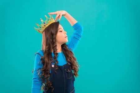 Feels like queen. Kid wear golden crown symbol of princess. Every girl dreaming to become princess. Lady little princess. Girl cute baby wear crown while stand blue background. Childhood concept.