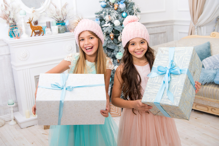 I cant believe in it. christmas time. Family. happy little sisters celebrate winter holiday. Cute little children girls with xmas present. happy new year. delivery christmas gifts. Stok Fotoğraf