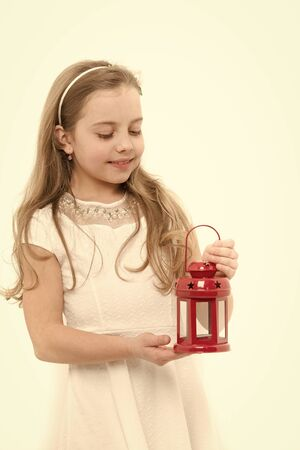 Christmas, new year, birthday. Girl smile with long blond hair isolated on white. Bright future concept. Child with red xmas lantern. Holiday celebration, anniversary.