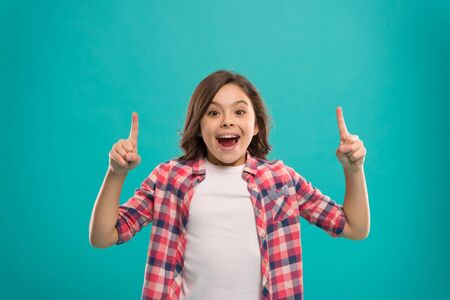 Girl cute surprised face found out important idea. Little girl long hair got bright idea. Little child smile excited with new idea stand over blue background. This is the point. Idea solution.
