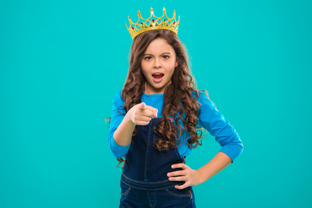 Not your princess. Kid wear golden crown symbol of princess. Girl cute baby wear crown while stand on blue background. Childhood concept. Every girl dreaming to become princess. Lady little princess.