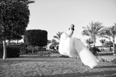 Bride concept. Bride hover in air. Bride in white wedding dress. Bride celebrate her special day. What a lovely dress.