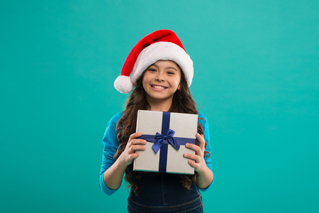 Happy winter holidays. Small girl. Little girl child in santa hat. New year party. Santa claus kid. Present for Xmas. Childhood. Christmas shopping. Christmas hope yours is all about the merry.